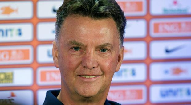 Netherlands head coach Louis Van Gaal was quickly installed as the bookmakers' favourite to succeed David Moyes as Manchester United manager