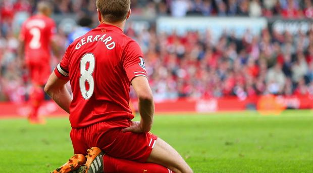 Liverpool's Steven Gerrard on his knees after his slip allowed Chelsea to s;core