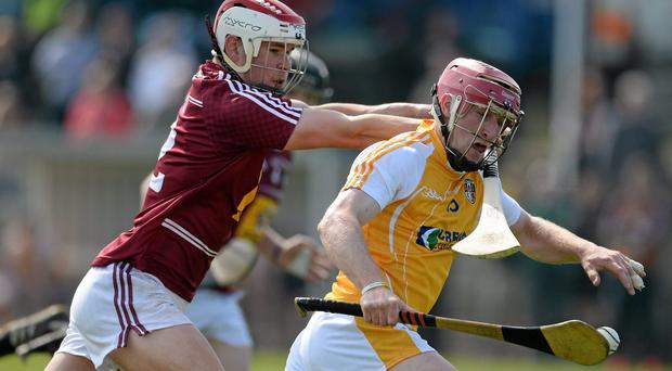 PJ O'Connell, Antrim, in action against Kieran Duncan, Westmeath