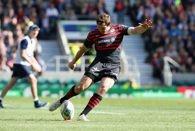Alex Goode of Saracens kicks a conversion during the Heineken Cup semi final match between Saracens and Clermont Auvergne at Twickenham Stadium on April 26, 2014 in London, England. (Photo by David Rogers/Getty Images)