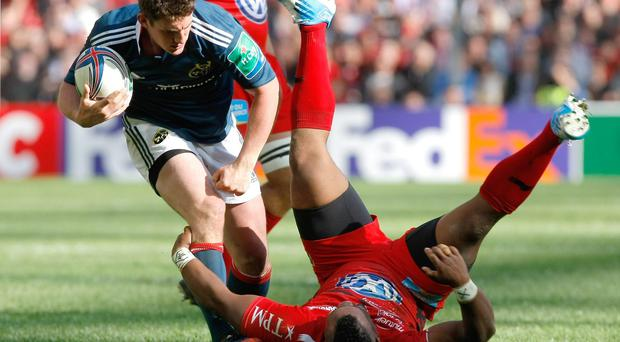 Munster's Fly Half Ian Keatley, left, is tackled by Toulon's French inside center Mathieu Bastareaud , during their Heineken European Cup semifinal rugby match, at the Velodrome stadium, in Marseille, southern France, Sunday, April 27, 2014. (AP Photo/Claude Paris)