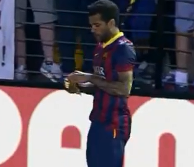 Dani Alves eats a banana thrown at him during Barcelona's 3-2 win over Villareal