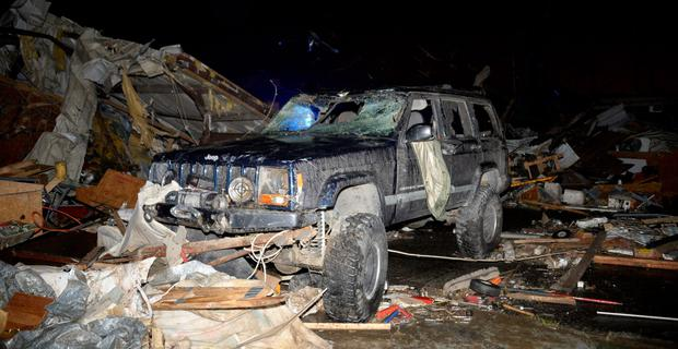 A damaged vehicle is seen after a tornado hit the town of Mayflower, Arkansas around 7:30 pm CST, late April 27, 2014. Tornadoes ripped through the south-central United States on Sunday, killing at least 12 people in Arkansas and Oklahoma and wiping out entire neighborhoods of homes, according to officials