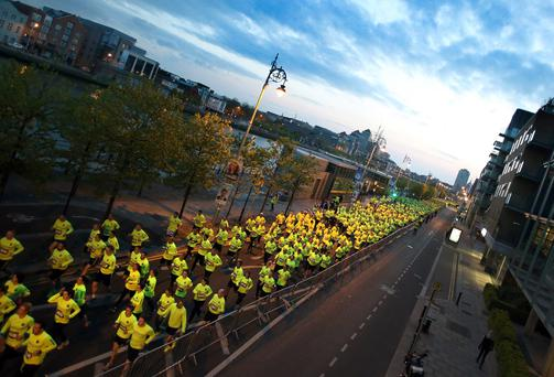 Almost 8,000 runners took to the traffic-free streets of Dublin and Cork city centres last night to participate in the Samsung Night Run, organised in partnership with Dublin and Cork City Councils respectively. The two 10k events took place simultaneously at 9pm, with one city crowned champion, based on the total average finishing time in each city. Photo: INPHO/Colm O'Neill