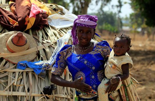 A wife of a Fulani herdsman is pictured with her baby in Zango, Zango-Kataf, Kaduna State, March 22, 2014. Reuters/Afolabi sotunde