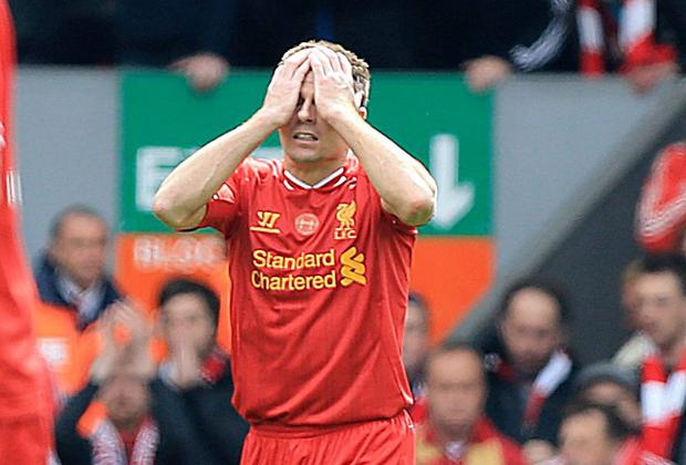 Liverpool's Steven Gerrard appears dejected during the Barclays Premier League match at Anfield