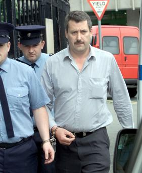 Former garda Austin Woods was found guilty of harassing his ex-girlfriend