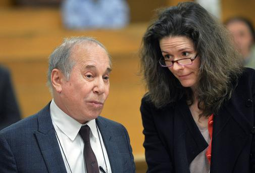 Paul Simon and his wife Edie Brickell at a hearing in Norwalk Superior Court, Connecticut. AP