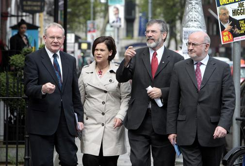 Sinn Fein's Martin McGuinness, Mary Lou McDonald, Gerry Adams and Caoimhghin O Caolain arrive for the unveiling of the Sinn Fein billboards, advertising and new posters across Dublin for the Euro and Local elections at Leinster House. Photo: Tom Burke