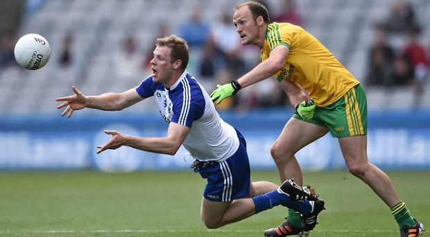 Owen Lennon, Monaghan, in action against Colm McFadden, Donegal. Picture credit: David Maher / SPORTSFILE
