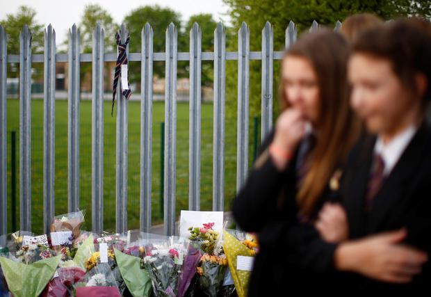 A school tie hangs from the fence of Corpus Christi Catholic College in tribute to teacher Anne Maguire who was fatally stabbed in Leeds, northern England April 28, 2014. West Yorkshire police said they were contacted shortly before noon after an ambulance crew attended a stabbing at the senior school, Corpus Christi Catholic College, in Leeds, 175 miles (280 km) north of London.REUTERS/Darren Staples (BRITAIN - Tags: CRIME LAW EDUCATION RELIGION)