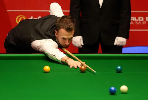 Judd Trump in action in the second round match against Ryan Day during the Dafabet World Snooker Championships at The Crucible, Sheffield