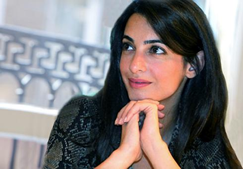 Amal Alamuddin, George Clooney's fiancee, is to represent one of Muammar Gaddafi's most notorious henchmen. Photo: PA