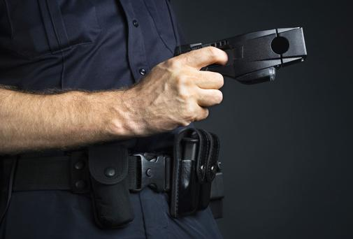 Addict who hijacked car threatened to taser son
