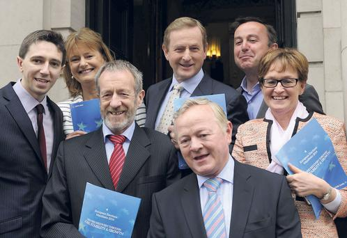 Enda Kenny, back row, second from right, at the launch of Fine Gael's European election campaign in Dublin, with the party's six MEP candidates, clockwise from Taoiseach, Brian Hayes TD, Mairead McGuiness MEP, Jim Higgins MEP, Sean Kelly MEP, Simon Harris TD and Senator Deirdre Clune.