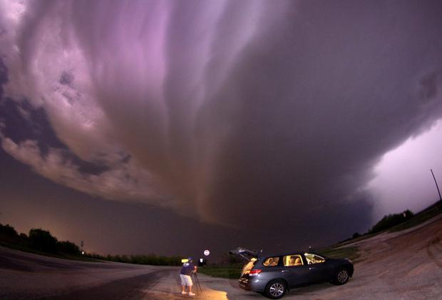 A large TVS (tornadic vortex signature) thunderstorm supercell passes over storm chaser Brad Mack in Graham, Texas