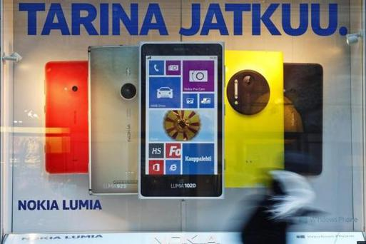 A pedestrian walks past a Nokia flagship store in central Helsinki January 23, 2014. REUTERS/Roni Rekomaa/Lehtikuva/Files