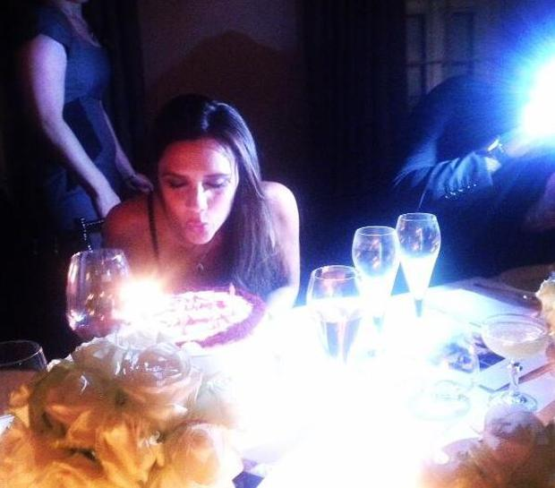 Victoria blows out the candles on her birthday cake (Photo: Twitter/Victoria Beckham)