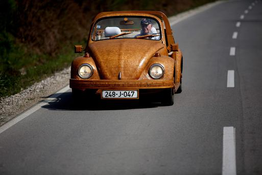 Bojic, 71, an avid Volkswagen fan, created the car from over 50,000 separate pieces of oak and took two years to complete it. Photo: Reuters/Dado Ruvic