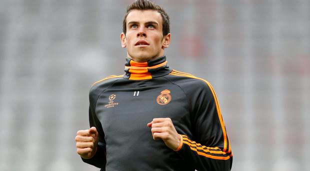 Real Madrid's Gareth Bale warms up during a training session ahead of their Champions League clash with Bayern