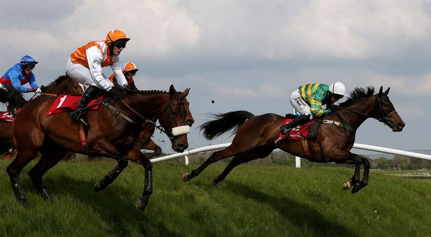 Be Positive ridden by Nina Carberry (right) comes over Ruby's Double on the way to winning the Kildare Hunt Club Fr Sean Breen Memorial Steeplechase during day one of the Punchestown Festival