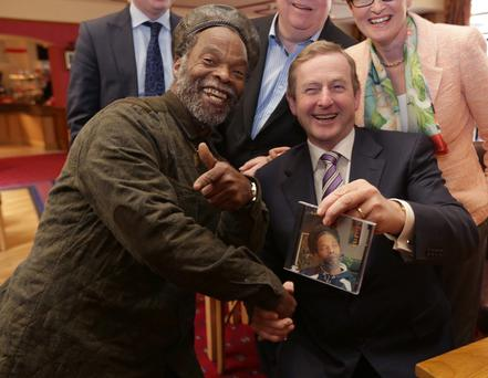 Natty Wailer, former member of The Bob Marley and the Wailers, presents a copy of his CD, Destiny to An Taoiseach, Enda kenny, TD, An Taoiseach, Enda Kenny, TD, was in Cavan town to canvass with local Fine Gael candidates. Picture credit; Damien Eagers 29/4/2014