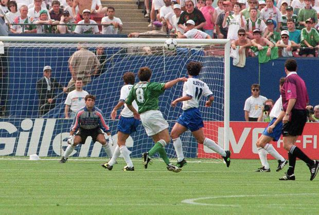 Ray Houghton scores against Italy at the 1994 World Cup. But the joy of the Giants Stadium was in stark contrast to the agony of the brutal murder of six in Co Down