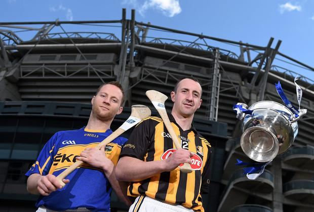 Paddy Stapleton, left, Tipperary, and Eoin Larkin, Kilkenny, with the Division 1 trophy. Croke Park, Dublin. Picture credit: Brendan Moran / SPORTSFILE