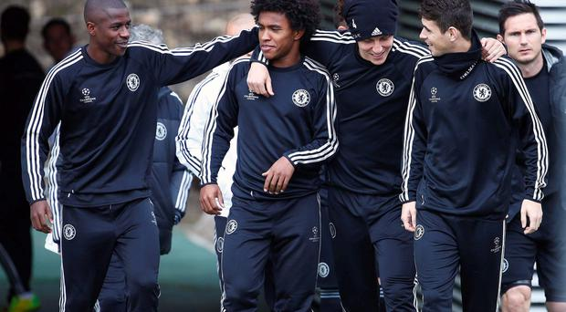 Chelsea's Brazilian players (L-R) Ramires, Willian, David Luiz and Oscar arrive for a soccer training session at Cobham in Surrey in south England. REUTERS/Eddie Keogh (BRITAIN - Tags: SPORT SOCCER)