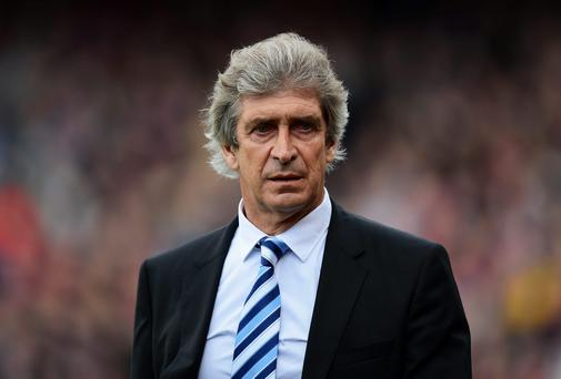 LONDON, ENGLAND - APRIL 27: Manuel Pellegrini, manager of Manchester City walks out for the Barclays Premier League match between Crystal Palace and Manchester City at Selhurst Park on April 27, 2014 in London, England. (Photo by Jamie McDonald/Getty Images)