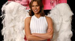 Victoria's Secret model Karlie Kloss poses for photos at the reveal for the new look of the fragrance