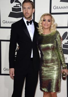 Rita Ora and Calvin Harris AFP PHOTO/ROBYN BECK