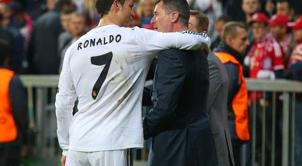 Ronaldo and Roy Keane at the Allianz Arena - Pic Credit: Twitter/@redarmynewsindo