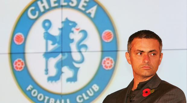 2004 - Chelsea manager Jose Mourinho looks on at the unveiling of the new Chelsea badge during a Chelsea Football Club press conference.