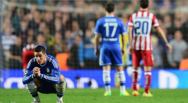 Fernando Torres of Chelsea looks away as Diego Costa of Club Atletico de Madrid prepares to take his penalty during the UEFA Champions League semi-final second leg match between Chelsea and Club Atletico de Madrid at Stamford Bridge on April 30, 2014 in London, England. (Photo by Jamie McDonald/Getty Images)