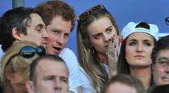 Britain's Prince Harry and Cressida Bonas watch the match during the Six Nations International rugby Union match between England and Wales at Twickenham, West London on March 9, 2014. AFP PHOTO/GLYN KIRK Getty Images