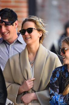 Jennifer Lawrence (C) with friends sighting in New York City. (Photo by Josiah Kamau/BuzzFoto/FilmMagic)