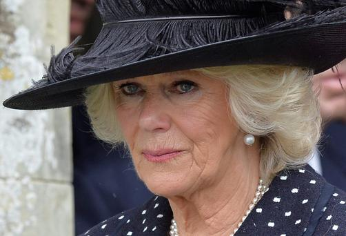 Britain's Camilla, Duchess of Cornwall leaves after attending the funeral of her brother Mark Shand, at Holy Trinity Church in Stourpaine, southern England May 1, 2014