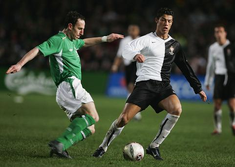 Andy O'Brien of Ireland tackles Cristiano Ronaldo of Portugal during the international friendly match at Landsdowne Road in February 2005