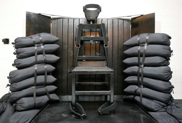 The firing squad execution chamber at the Utah State Prison in Draper, Utah, is shown. Used mostly in the 19th and 20th centuries, it was also used in 1977 in Utah to execute Gary Gilmore, the first inmate put to death after the US Supreme Court allowed capital punishment to resume, and two other Utah inmates. Some experts consider it the quickest and least painful method. AP