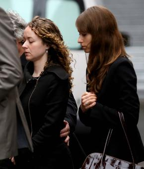 Ann Maguire's two daughters, Kerry (32) and Emma (30), arrive at Leeds Youth Court as a pupil of Corpus Christi Catholic College appears in court