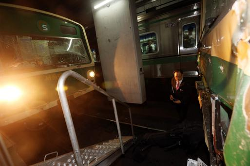 An official stands between damaged subway trains at a subway station in Seoul May 2, 2014.
