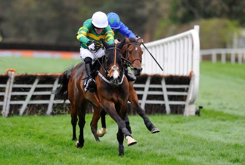 Tony McCoy riding Jezki clears the last to win The Racing Post Champion Hurdle from Hurricane Fly at Punchestown