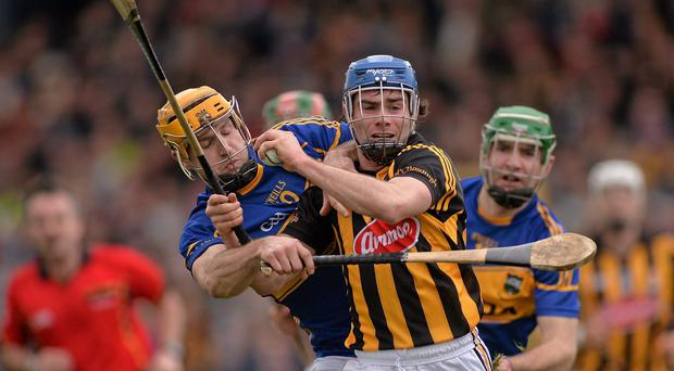 Kilkenny's Brian Kennedy battles for possession with Tipperary's Kieran Bergin