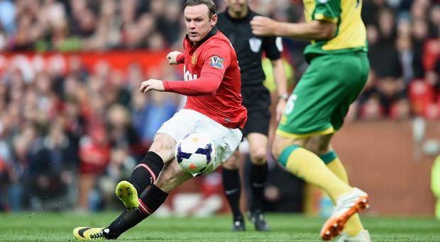 Wayne Rooney is determined to play against Sunderland today despite having sustained a groin strain. Photo: Laurence Griffiths/Getty Images