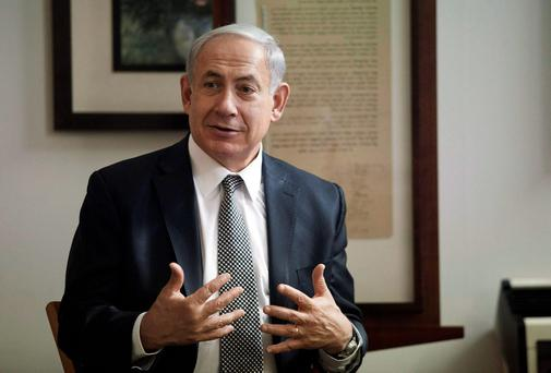 Israeli Prime Minister Benjamin Netanyahu said he would seek to enact a law to define Israel as a Jewish state, a step certain to raise opposition from Arab citizens who make up a fifth of the population
