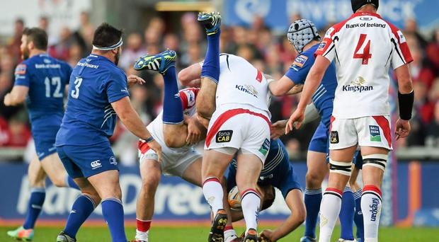 Leinster's Devin Toner is tackled by Tom Court, resulting in a red card for the Ulster player. Photo: Stephen McCarthy / SPORTSFILE