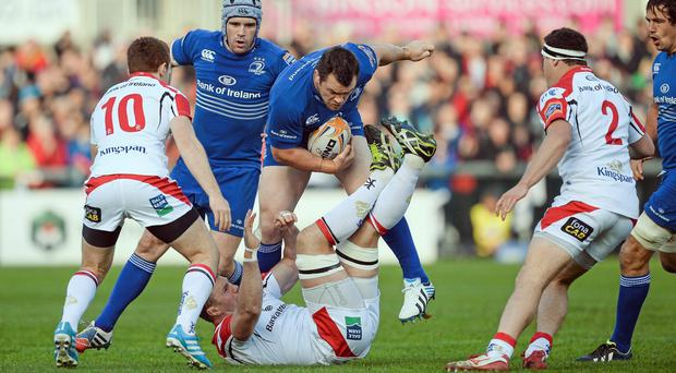 Leinster's Cian Healey, bulldozes over Roger Wilson as his side drive forward. Photo: Oliver McVeigh / SPORTSFILE