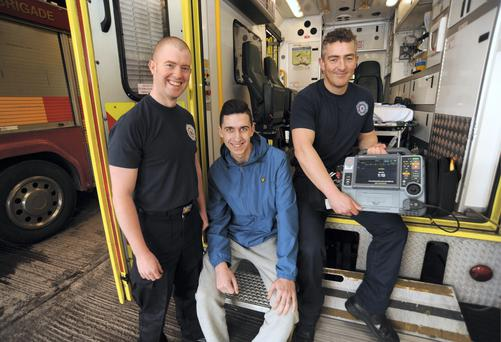 Roberto Rea (17) from Artane, with firemen/paramedics: Robert Hedderman, left, and Donal Brennan, from North Strand. Dublin Fire brigade North Strand, Dublin. Picture: Caroline Quinn