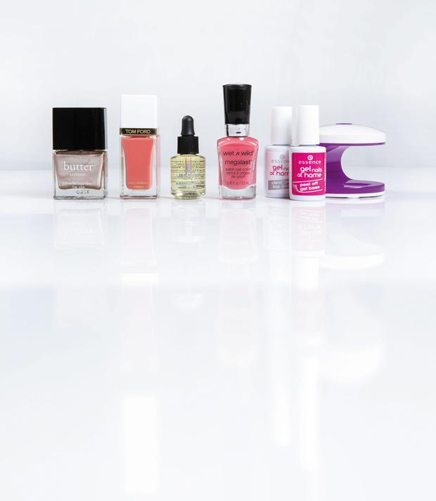 Pictured, from left: butter London 3 Free Nail Lacquer in Goss; Tom Ford Nail Lacquer in Coral Beach; Jessica Phenom Oil; wet n wild megalast salon nail colour in Tropicalia; essence gel nails at home clear gel top coat; peel off gel base; and mini LED lamp
